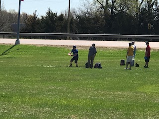 Kids playing disc golf
